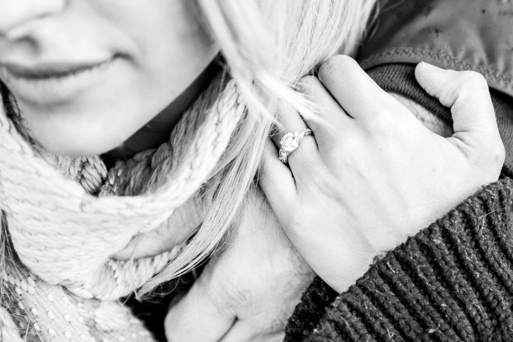 An engagement ring photo - one of the must have engagement shoot photos. This one is in black and white.