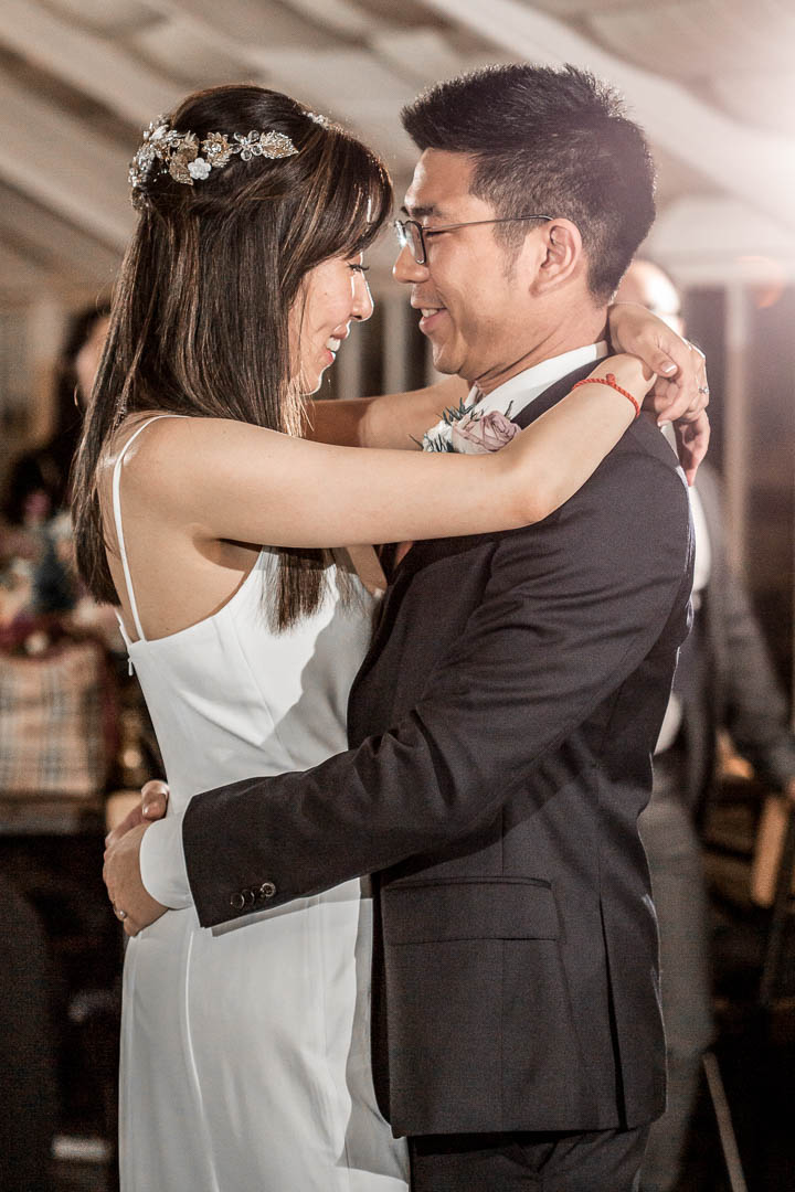 A bride and groom have their first dance in the Potting Shed in Hertfordshire's Potting Shed, part of The Grove Five Star Luxury Hotel on the outskirts of London.