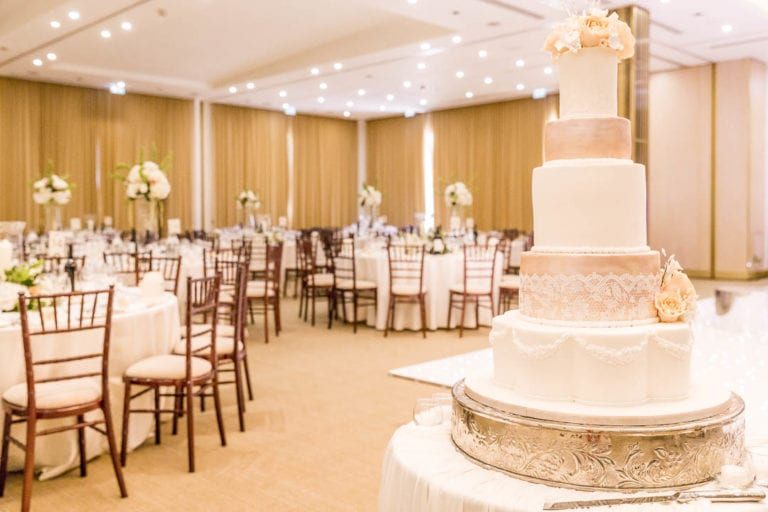 A five-tier wedding cake in apricots and creams awaits the bride and groom in The Grove's Amber Suite. The Amber Suite takes more than 400 wedding guests and is just 20 minutes from central London.