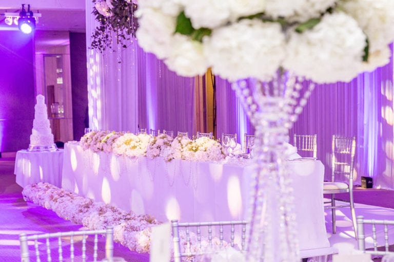 Clear glass beads, tall vases and white florals decorate the Amber Suite at The Grove.
