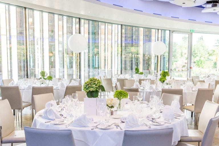 Watford's five star wedding ceremony and reception venue The Grove and its Cedar Suite which takes up to 130 wedding guests. This shows the floor to ceiling windows that open out onto a private terrace and the 300 acres of grounds beyond.
