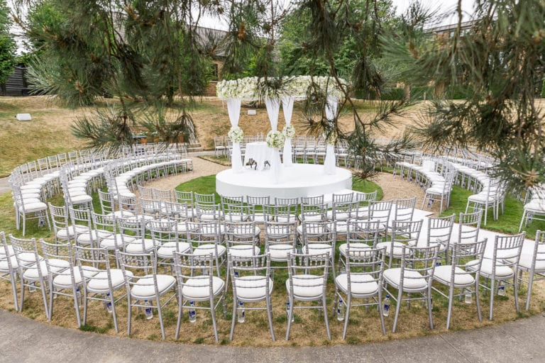 Exchange vows in the midst of your family and friends in this sunken garden at The Grove, Hertfordshire. Wedding photographer: Natalie Chiverton.