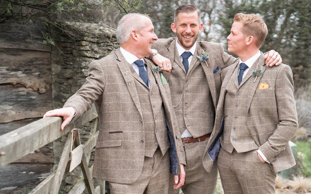 Tetbury wedding venue Great Tythe Barn with a groom and his two groomsmen before his marriage ceremony.