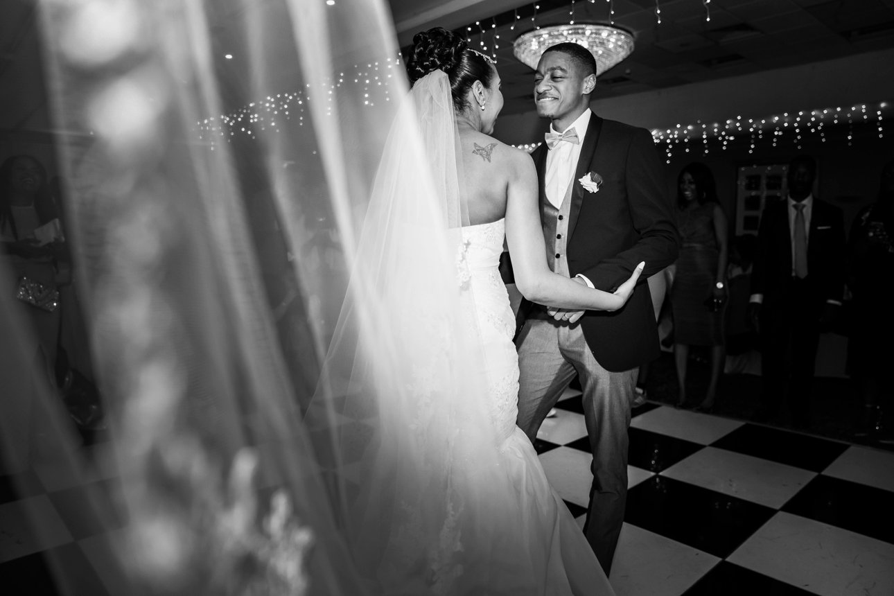 A black and white photo of a bride and groom's first dance.