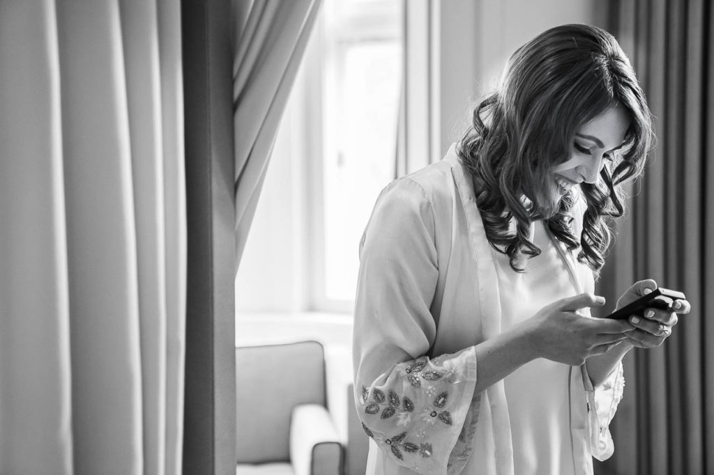 A bride reads a note on the morning of her wedding.