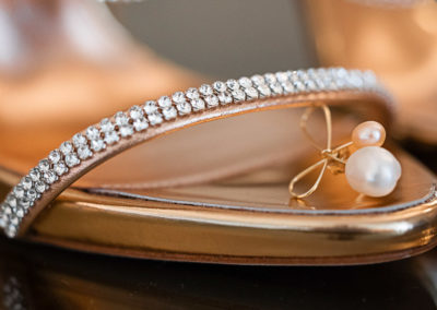 Diamante-strappy-wedding-shoes-with-gold-soles-and-pearl-jewellery.