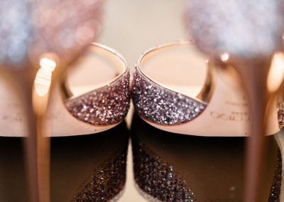 jimmy-choo-pink-sparkling-wedding-shoes-showing-off-the-stiletto-heels-in-warm-rose-gold.