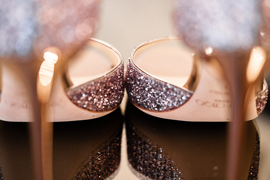 Jimmy Choo pink sparkling wedding shoes showing off the stiletto heels in warm gold.