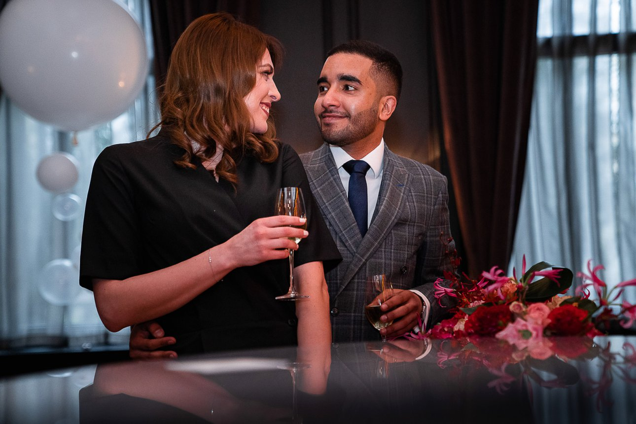 A bride and groom celebrating their wedding in Fitz's Bar in the Kimpton Fitzroy London in Bloomsbury.