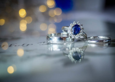 blue-sapphire-engagement-ring-and-platinum-wedding-rings