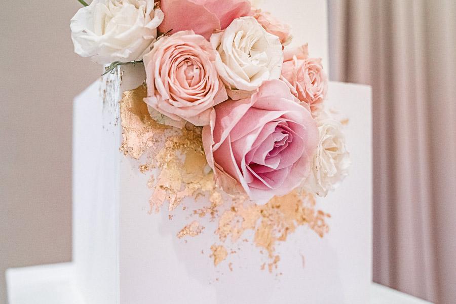 A white square wedding cake by London cake designer Gayas Cakes.