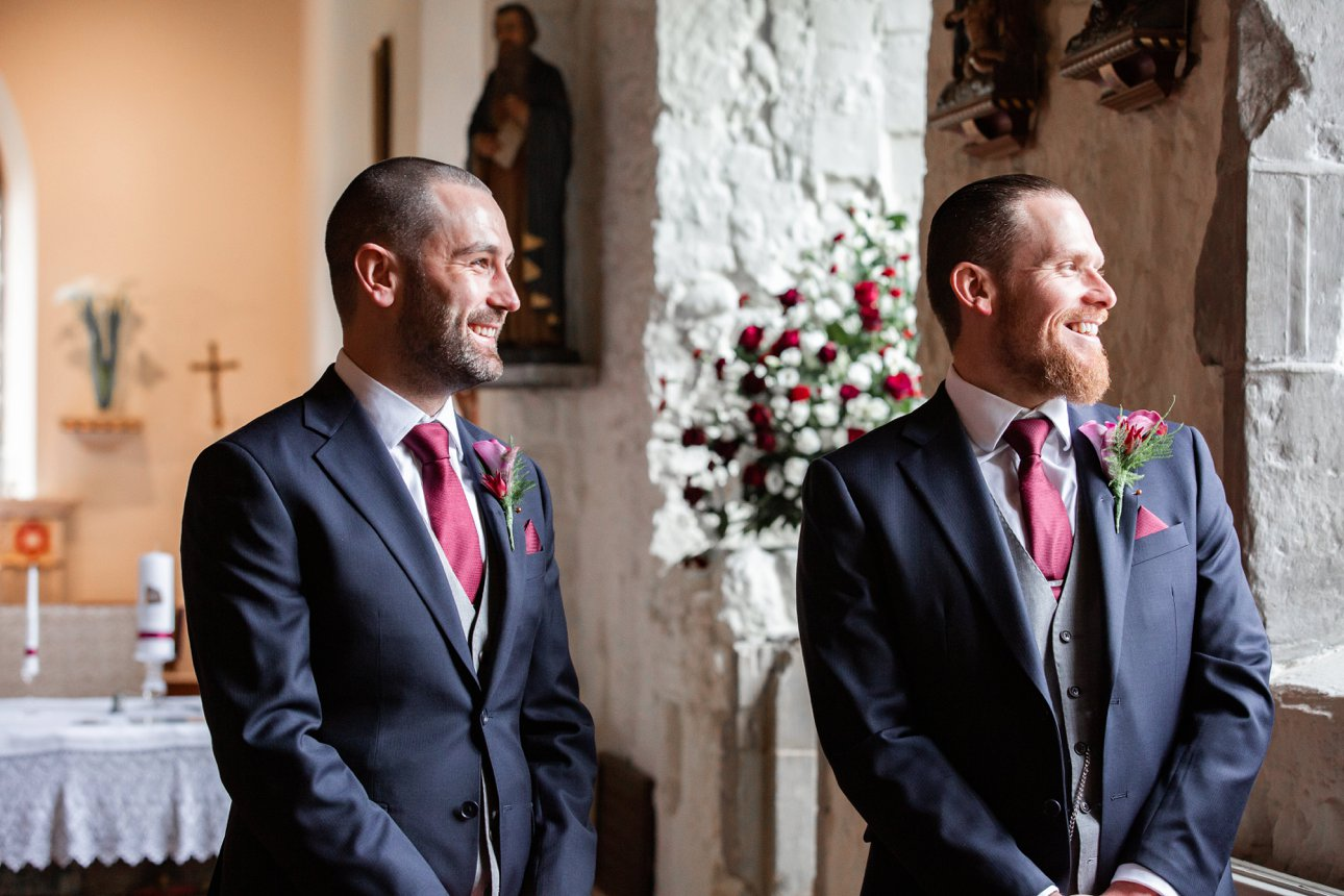 Groom Karl and his best man wait at St Peter and St Paul, Hockley, for their guests and bride Elisa.