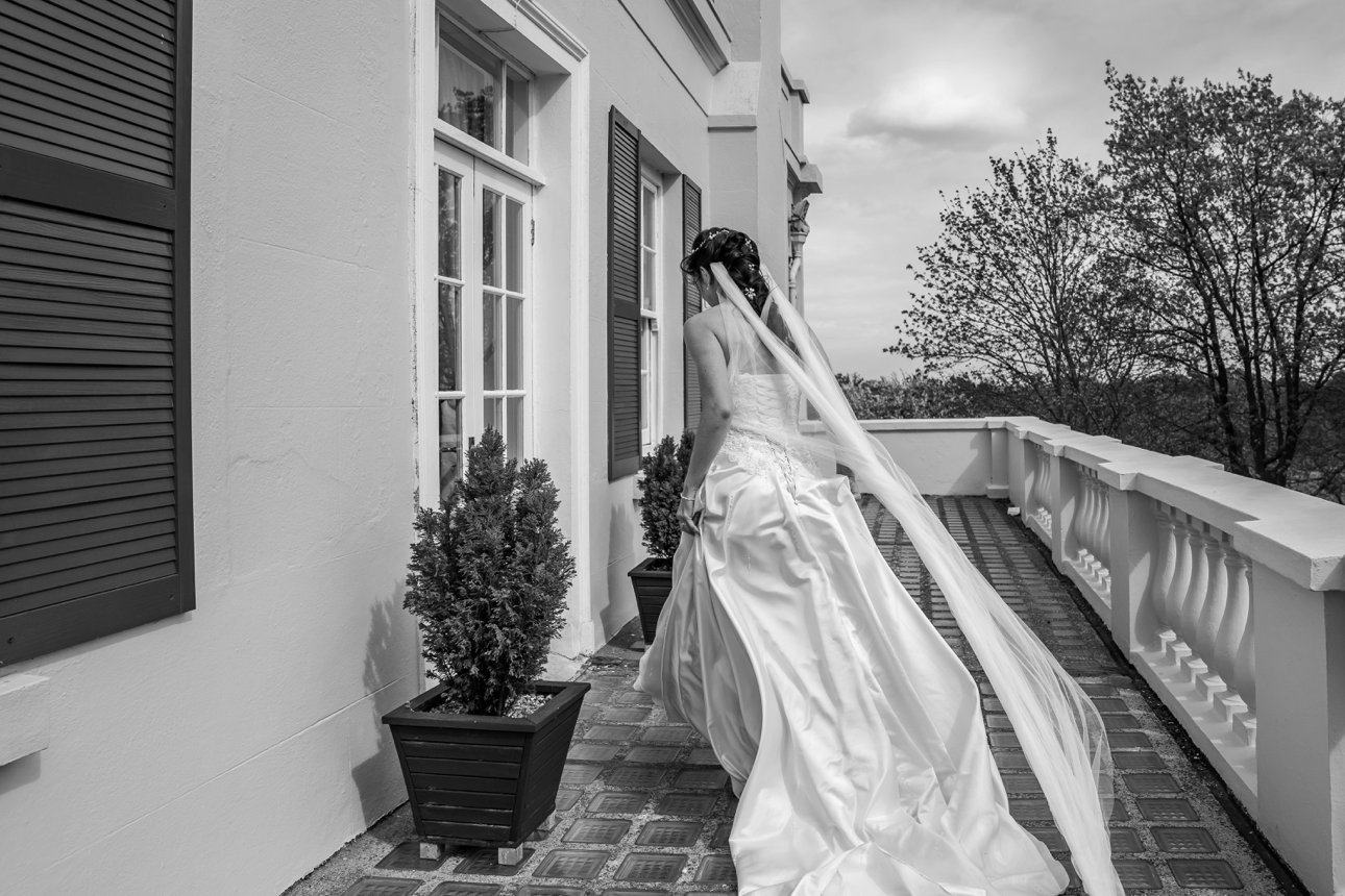 A captured moment of a bride at Rochford's The Lawn after her wedding ceremony.