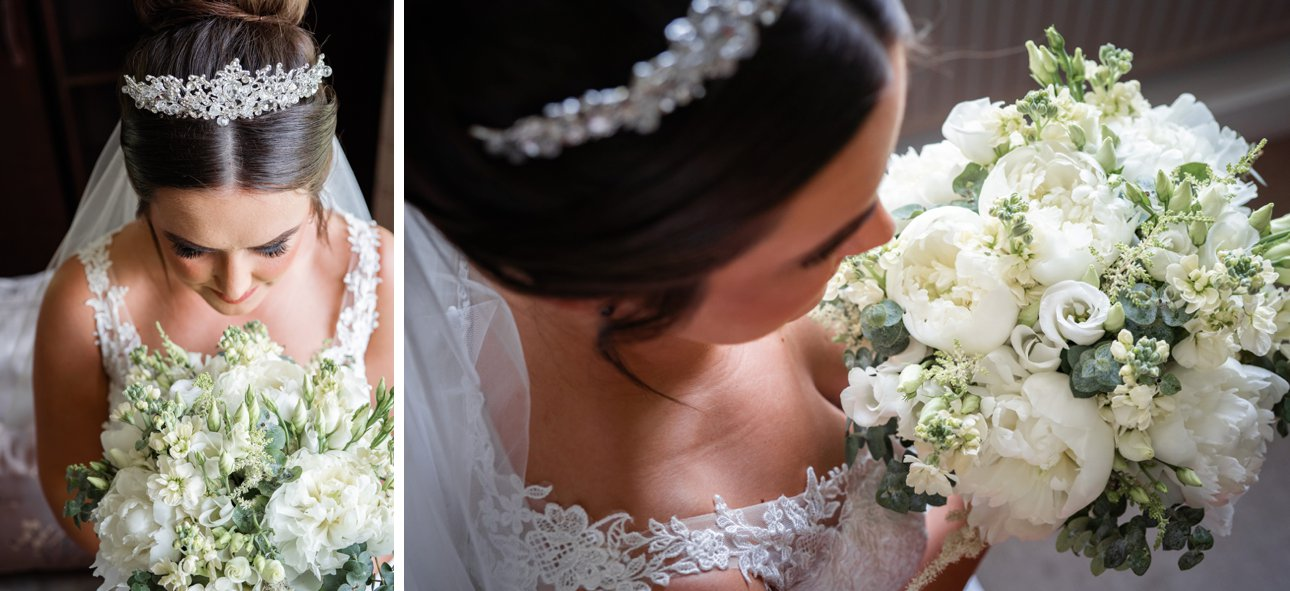 Bride Cora looks at her white peony and eucalyptus bouquet on the morning of her wedding at The Manor Elstree.