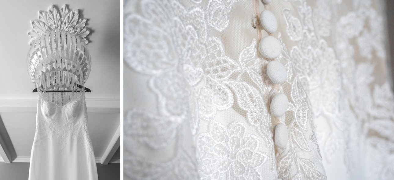 A white lace wedding dress by bridal designer Anna Sorano dress from WedtoBe hangs from a ceiling light fitting at The Manor Elstree - A Laura Ashley hotel. It has covered white buttons on the back.