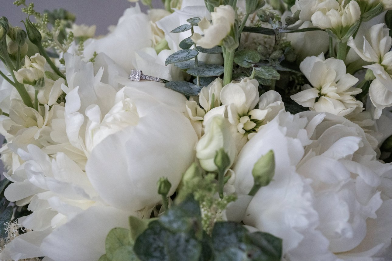 White bridal bouquet including white peonies and eucalyptus leaves is from Fabulous Floristry by Cara, based in Hertfordshire.