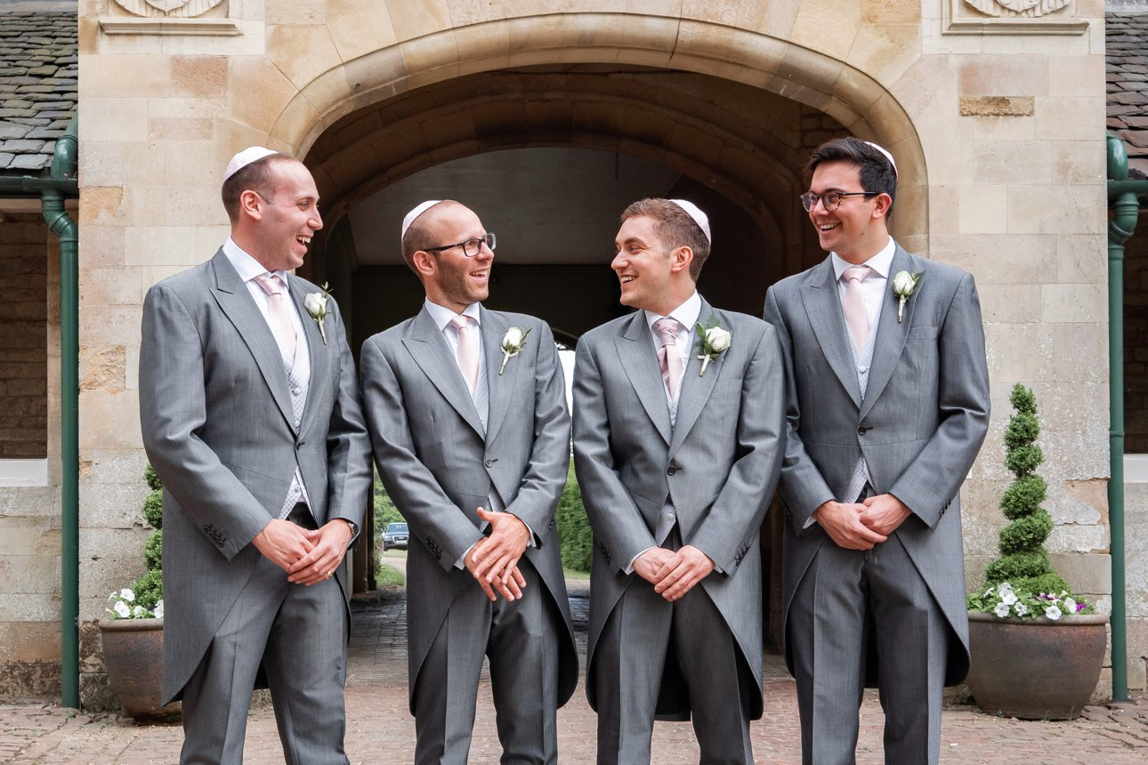 A groom and groomsmen ready for a Stapleford Park wedding.