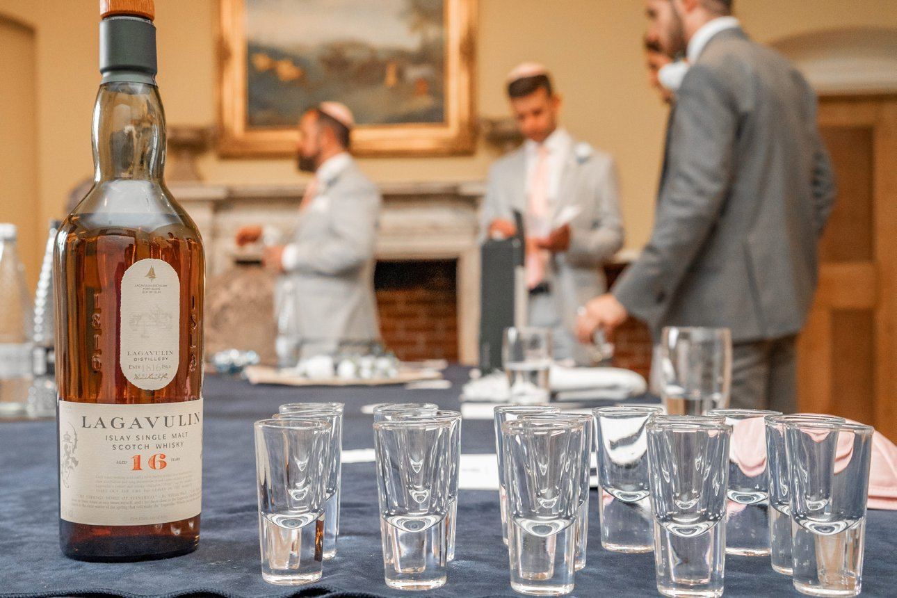 A quick drink for the groom and his groomsmen at Stapleford Park.