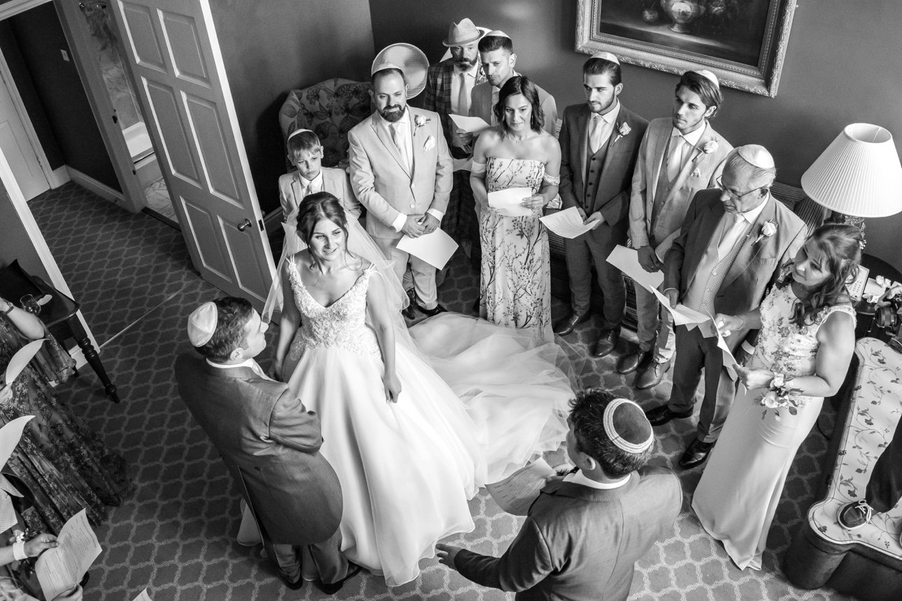 A bride and groom take part in the badeken - the first part of their Jewish marriage ceremony.