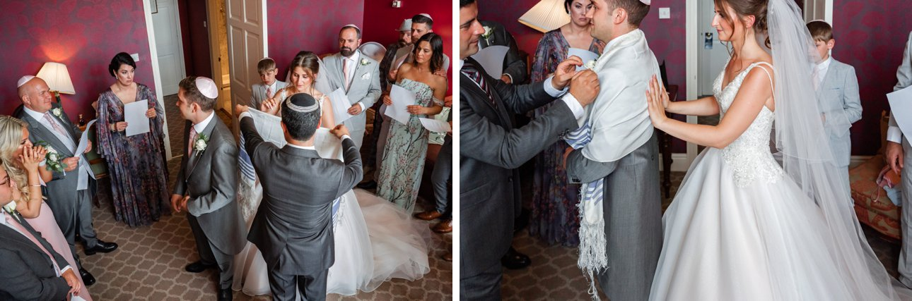 A groom puts on his tallit or fringed prayer shawl during the badeken part of the Jewish wedding ceremony.