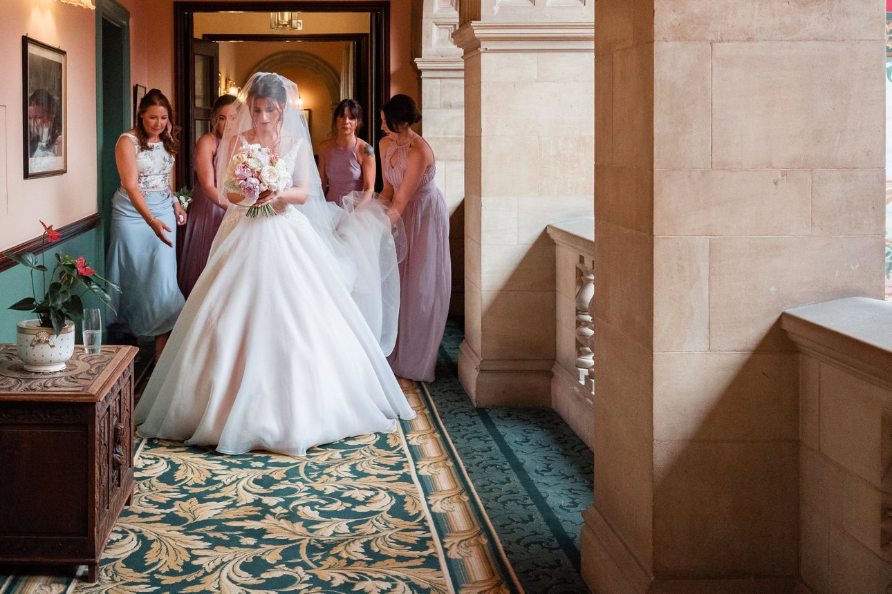 A bride and her bridesmaids leave the badeken and head towards the second part of her wedding ceremony at Stapleford Park Country Park Hotel in Leicestershire.