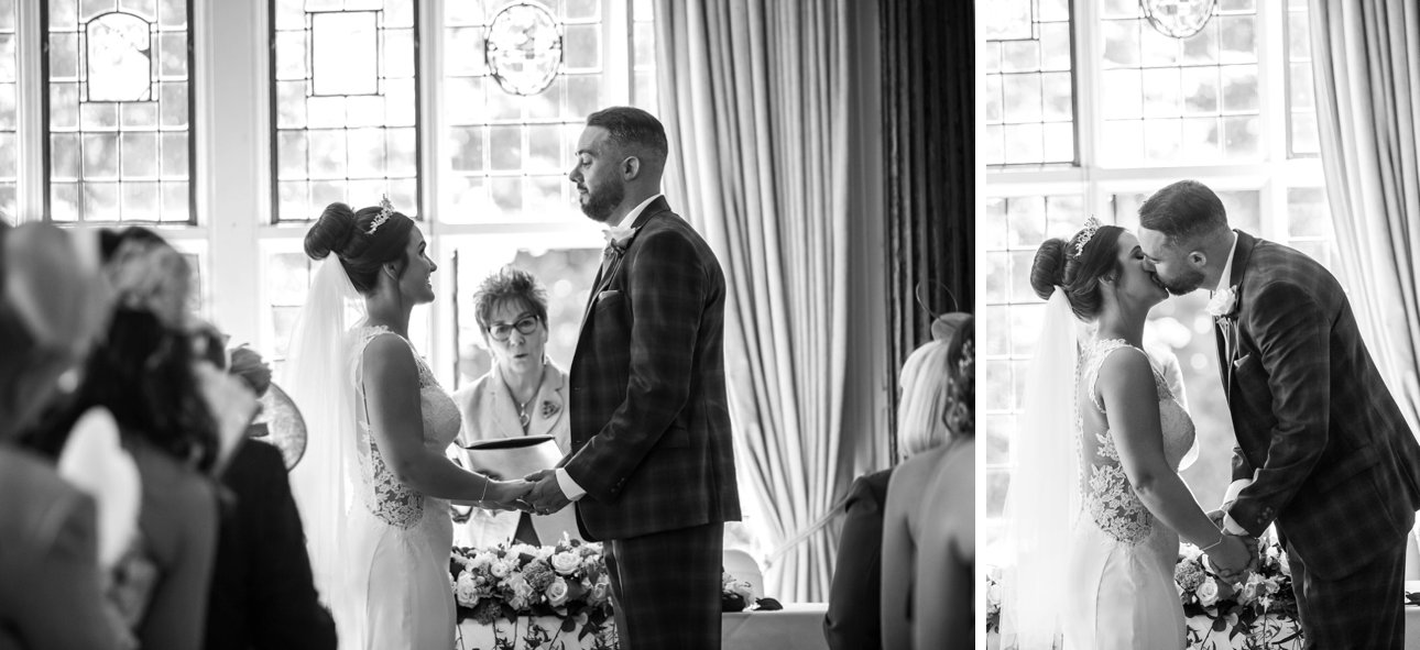Elstree Manor Hertfordshire wedding ceremony - the bride and groom kiss after exchanging vows.