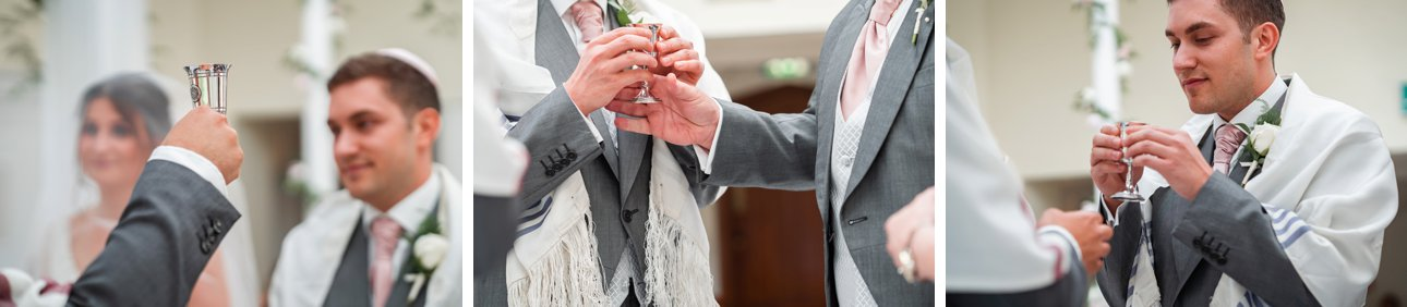The bride, groom and their families sip from two cups of wine during their Jewish Stapleford Park wedding ceremony.