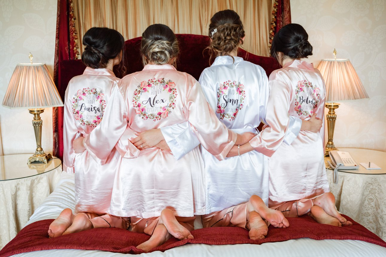 Bride Sonni and her three bridesmaids wear customised bridesmaid wraps on her wedding morning.