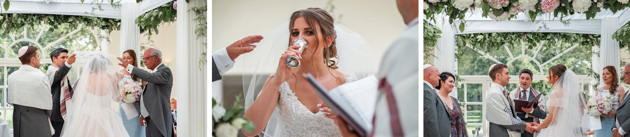 The bride, groom and families sip from two cups of wine during at Jewish wedding ceremony at Leicestershire wedding venue Stapleford Park.