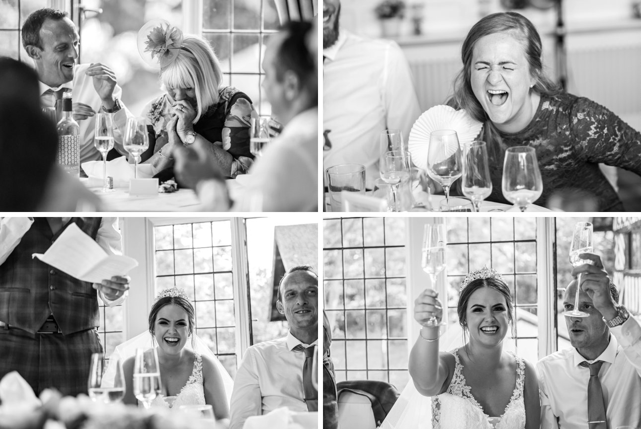 Guests giggle and laugh during the wedding speeches.