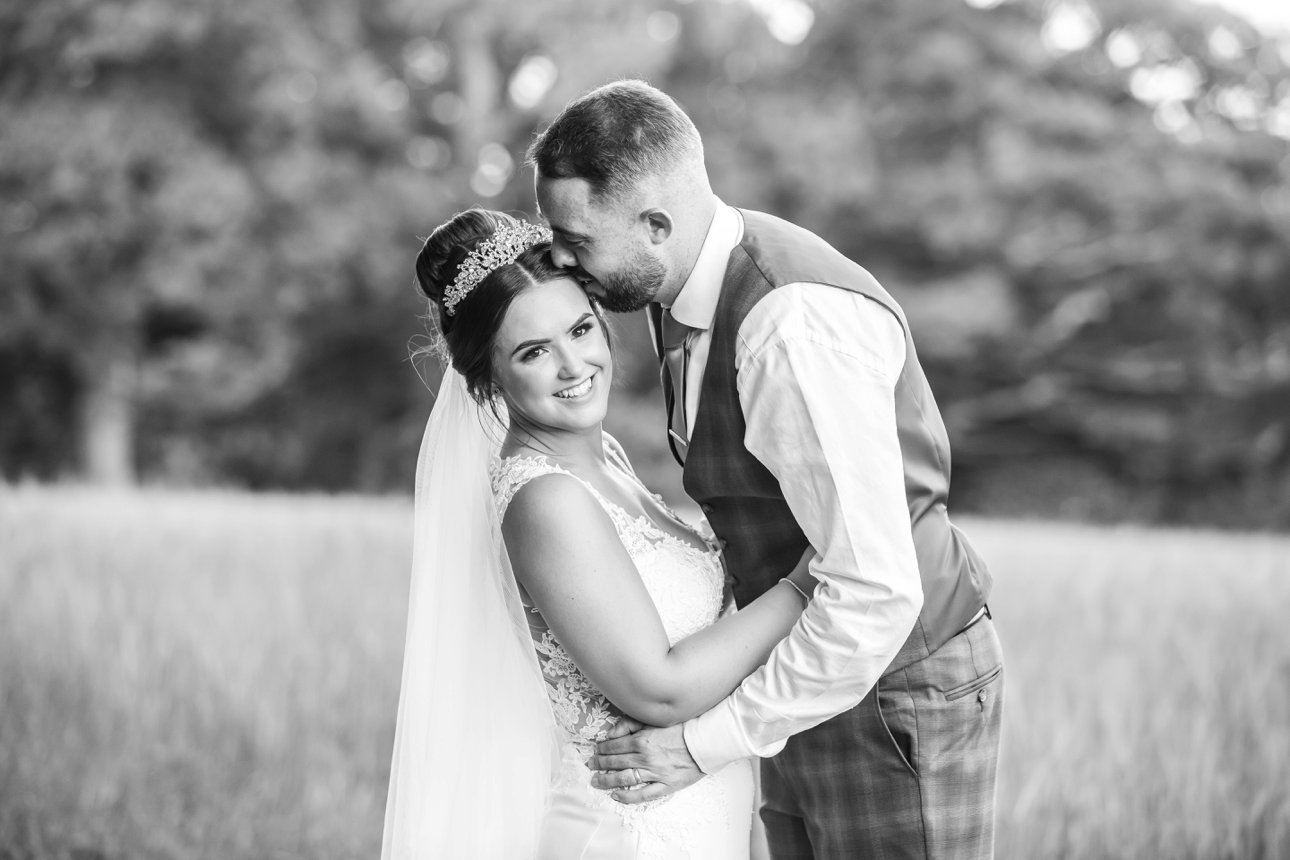 Bridal portraits of Cora and Andrew in the fields around The Manor Elstree in Hertfordshire.