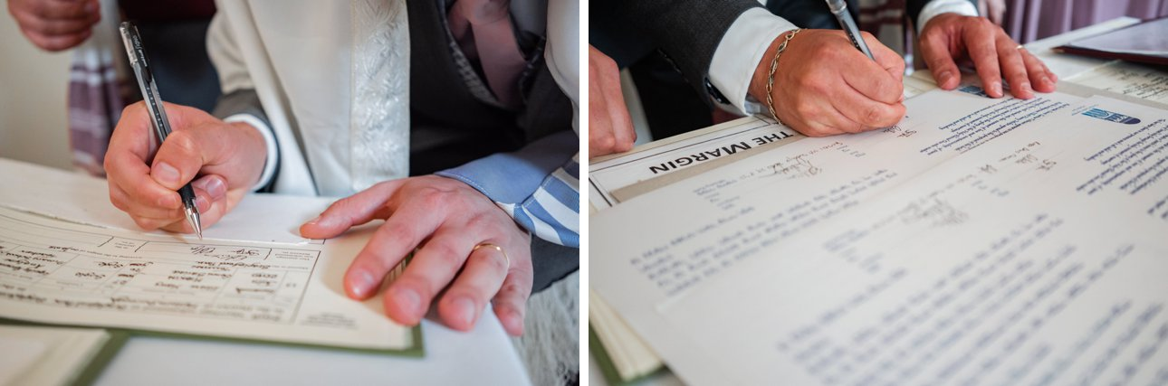 The bride and groom sign the marriage register and Jewish marriage paperwork to complete their wedding administration.
