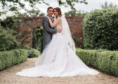 bride-groom-in-walled-garden-at-stapleford-park