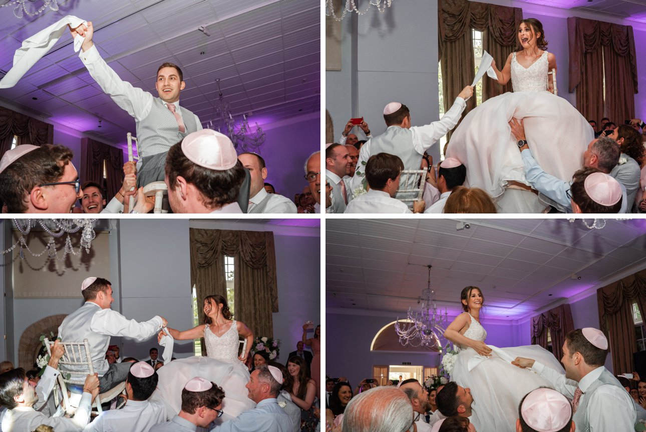 The bride and groom are carried on chairs by their wedding guests as part of traditional Jewish wedding dancing.