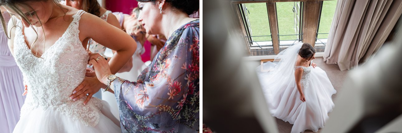 Bride puts on her Paul Zeni wedding dress with the help of her mother and bridesmaids.