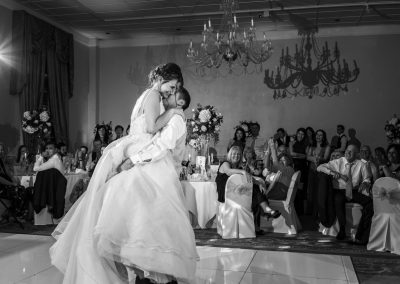 groom-lifted-bride-dancing-at-leicestershire-wedding-venue-stapleford-park