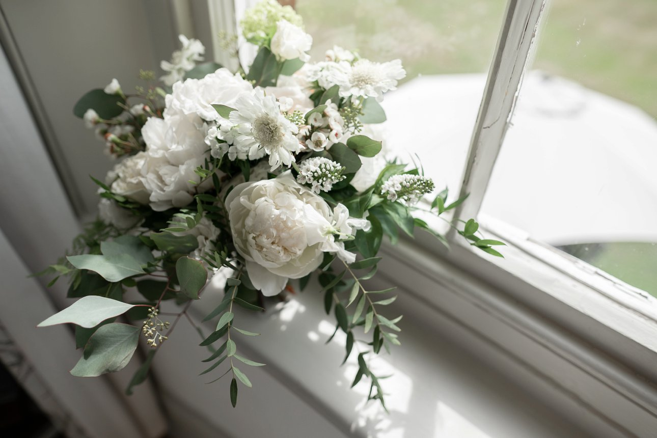 A white summer bouquet by florist Rebecca Marsala at Buckinghamshire wedding venue Stoke Place Slough.