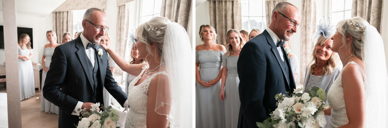 Father of the bride sees his daughter ads a bride in a white veil for the first time.
