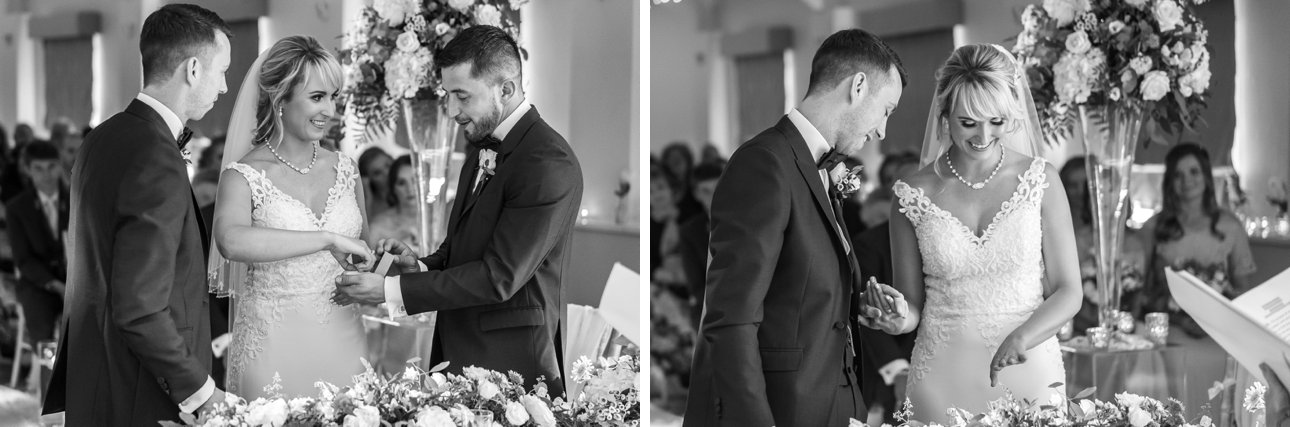 The best man hands the bride her groom's wedding ring during the marriage ceremony at Stoke Place Slough.