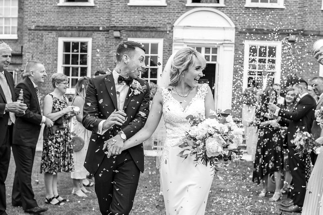 Newlyweds Laura and Karl leave Stoke Place Slough in a whirl of confetti after their wedding in the Buckinghamshire Queen Anne mansion.