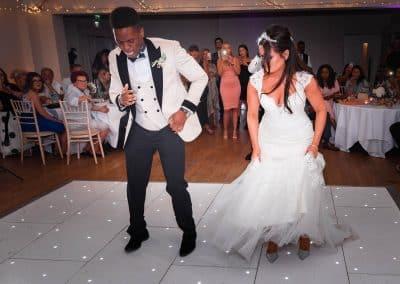 bride-and-groom-dancing-on-white-dance-floor