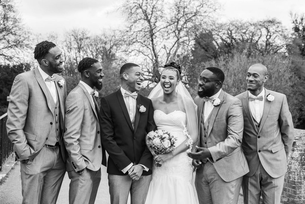 A bride, her groom and groomsmen.