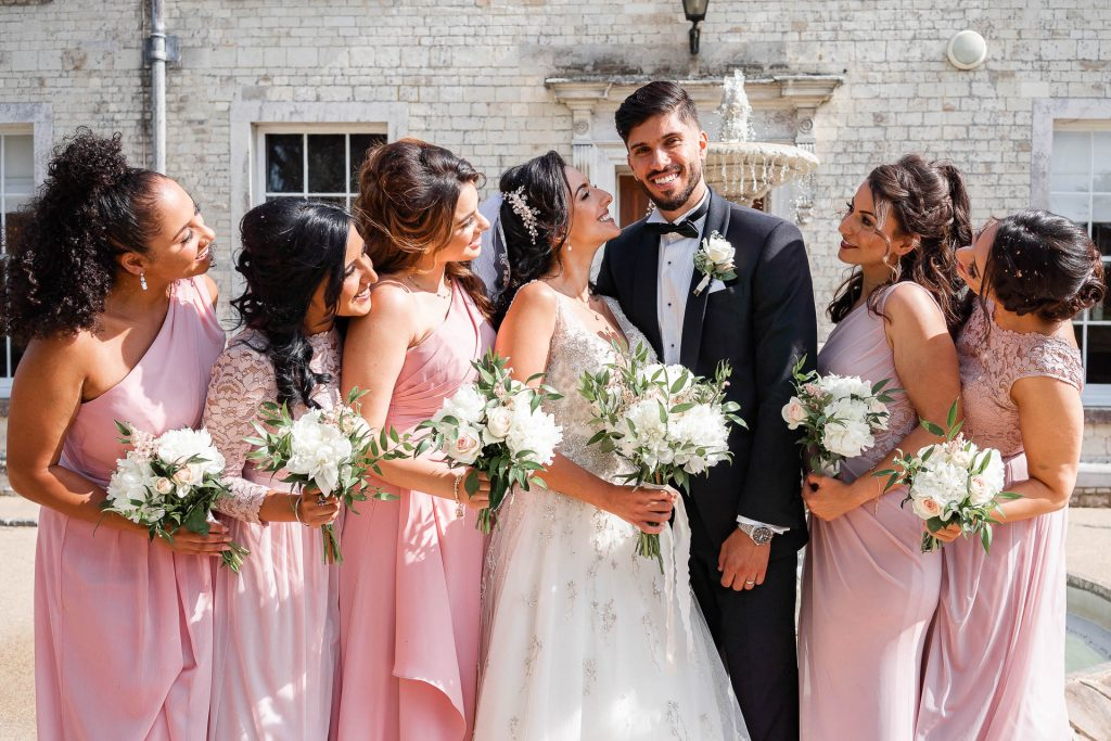 A groom and groom with the bridesmaids.