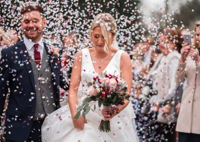 couple-walking-through-the-confetti