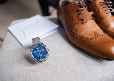 groom-tan-shoes-with-mens-tissot-watch-with-a-blue-face