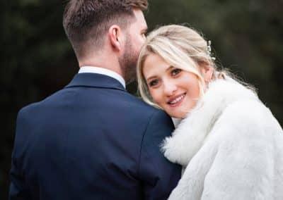 bride looking over groom shoulder