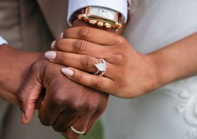bride-and-groom-holding-hands-with-diamond-gold-rings
