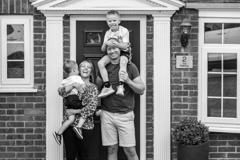 Black and white family portrait on doorstep