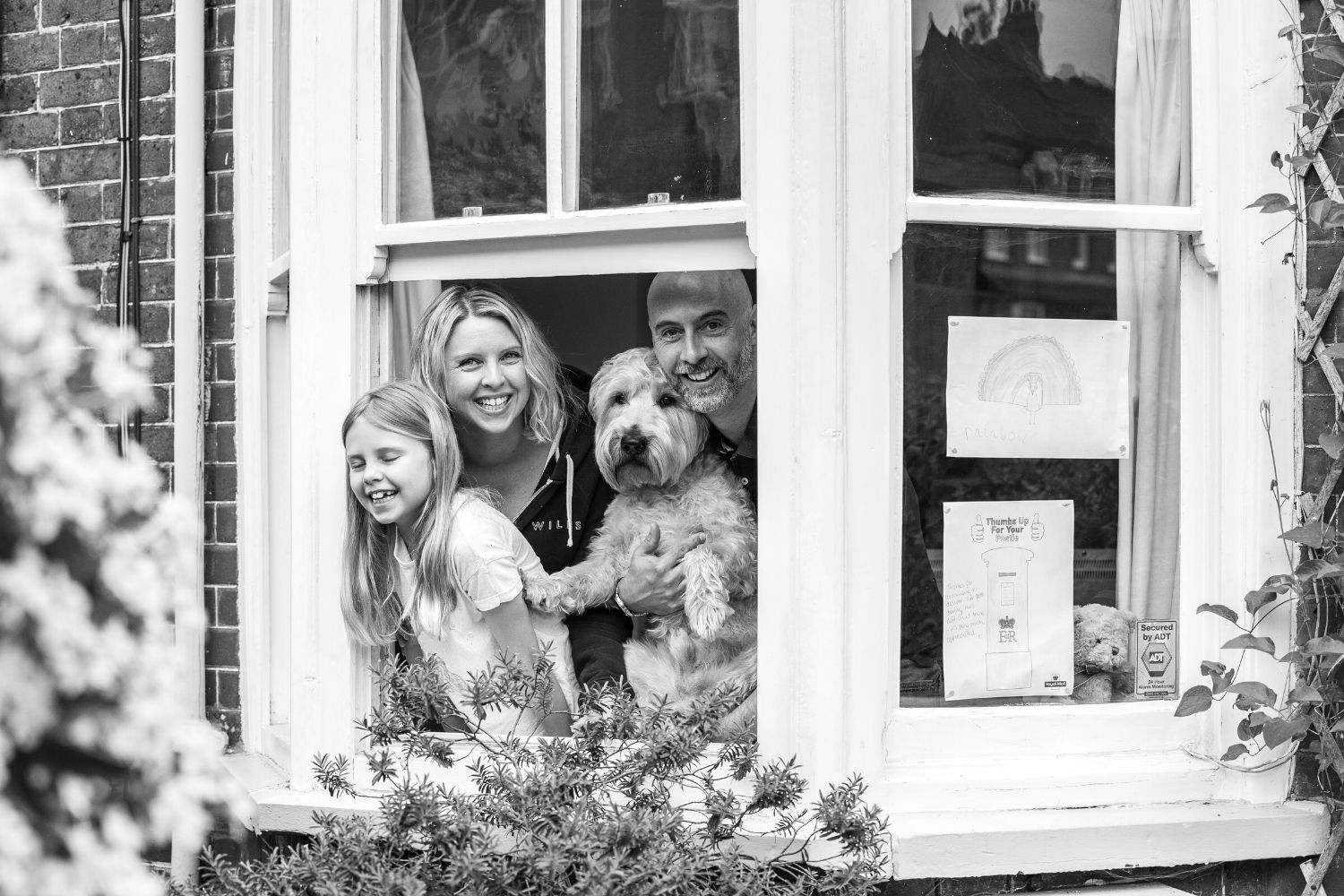 Family and dog black and white window photograph