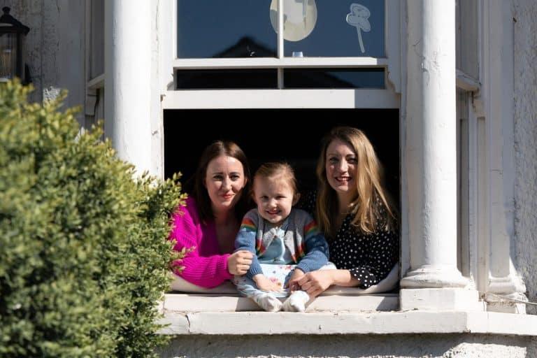 Window portrait of family of three